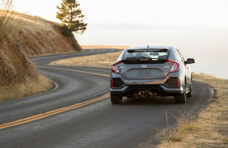 2018 Honda Civic Hatchback rear end view as it drives