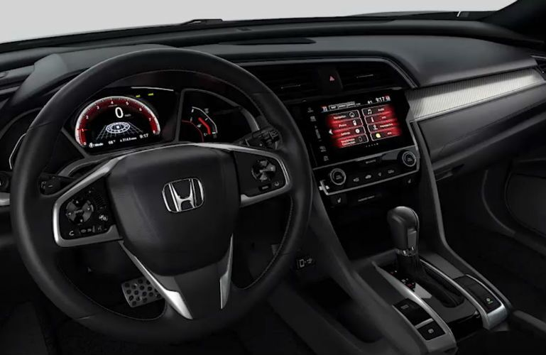 2018 Honda Civic Hatchback steering wheel and center console with red accent lighting