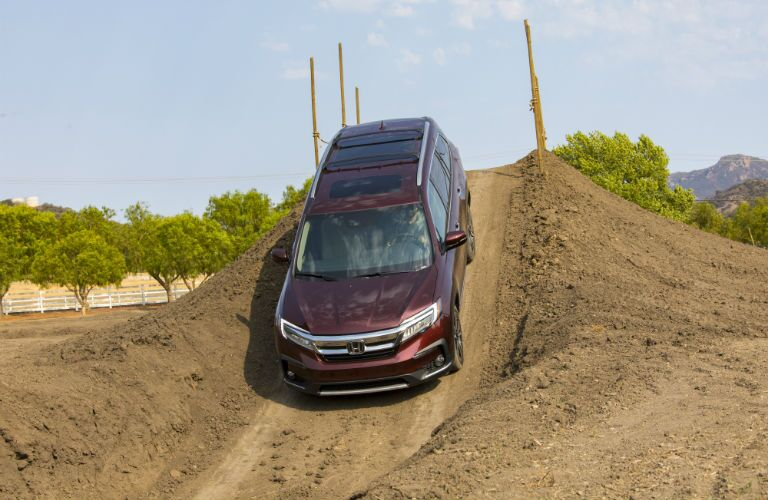 2019 Honda Pilot Elite going down a steep dirt hill