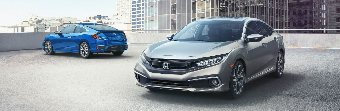 2019 Honda Civic Sedan and 2019 Honda Civic Coupe on a parking garage roof