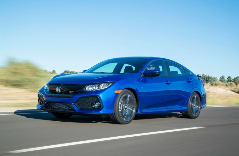 2019 Honda Civic Si Sedan in Aegean Blue Metallic driving on a desert road
