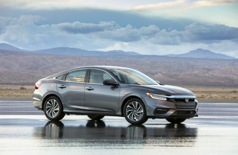 2019 Honda Insight parked on wet pavement in the desert