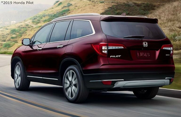 2019 Honda Pilot with available Traction Management System driving fast