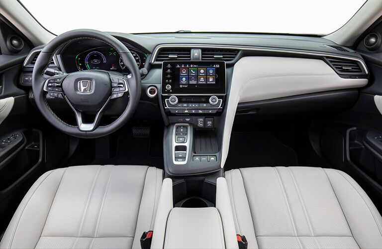 2020 Honda Insight interior shot of front seating upholstery, interior accenting trimming, and steering wheel and dashboard design