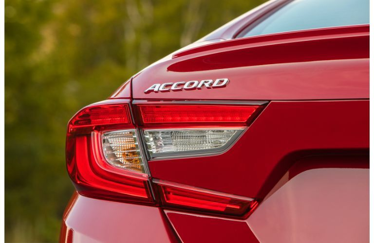 2020 Honda Accord Sport exterior closeup of rear end, taillights, and model badge with red paint color