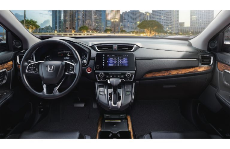 2020 Honda CR-V Touring interior shot of steering wheel, dashboard, and windshield view