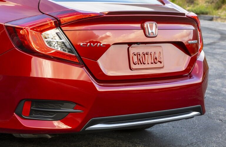 2020 Honda Civic Sedan Touring exterior rear closeup of trunk, taillights, and back bumper with Molten Lava Pearl paint color