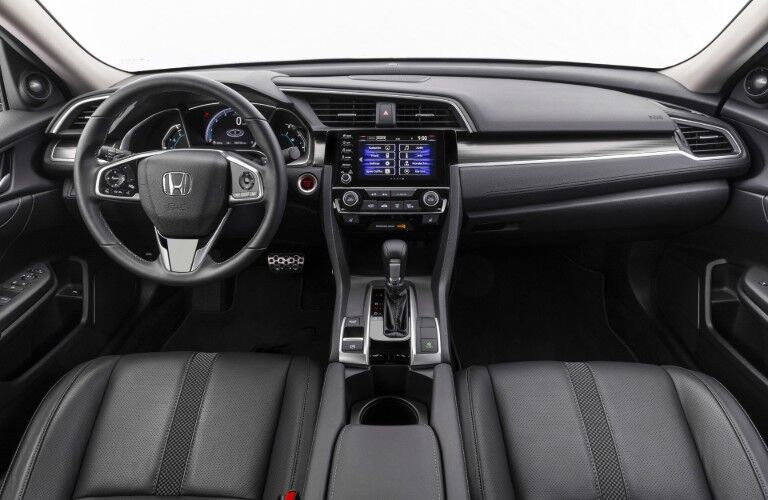 2020 Honda Civic Sedan Touring interior shot of front seating upholstery, steering wheel, transmission, and dashboard design and layout