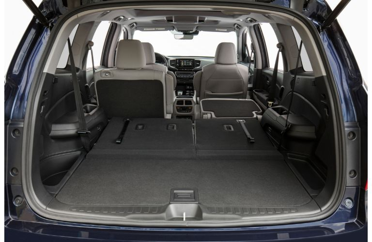 2020 Honda Pilot Elite interior shot of maximum cargo capacity with folded down seats