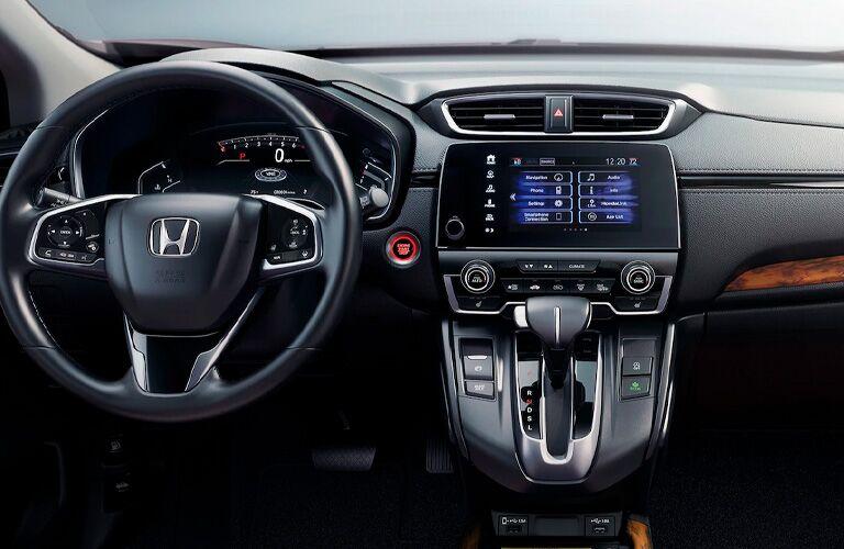 2021 Honda CR-V interior shot of steering wheel, transmission, and dashboard layout