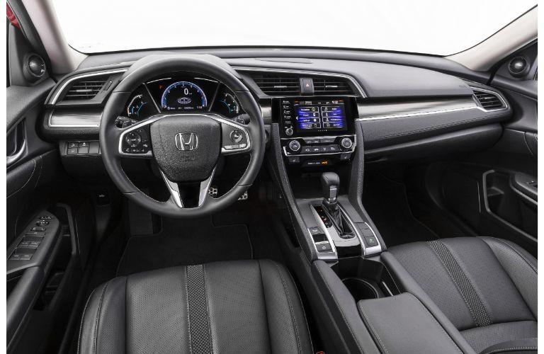 2021 Honda Civic Sedan Touring interior shot of front seating, steering wheel, transmission, and dashboard layout