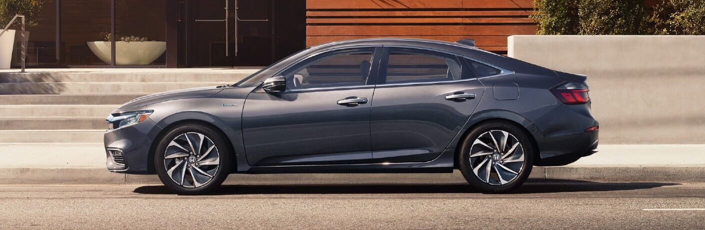 2021 Honda Insight exterior side shot with Modern Steel Metallic paint color parked outside a fancy home