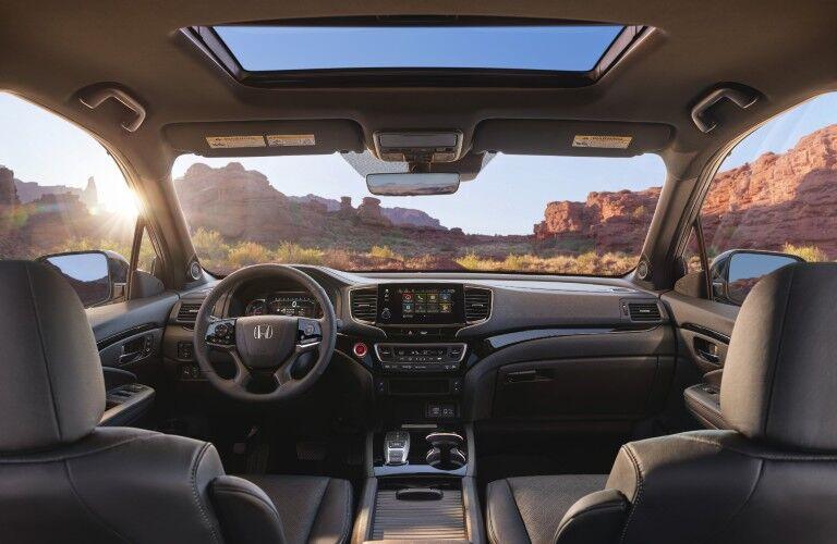 2021 Honda Passport interior shot of front seating, steering wheel, moonroof, and dashboard