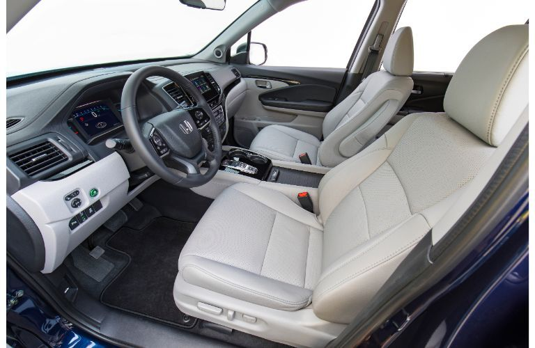 2021 Honda Pilot Elite interior side shot of front seating with white coloring