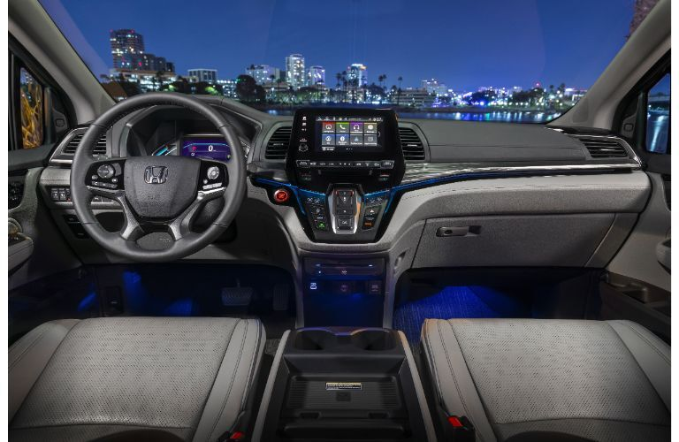 2022 Honda Odyssey interior shot of front seating, steering wheel, and dashboard layout