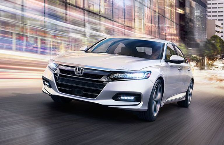 2018 Honda Accord driving downtown with streaking lights