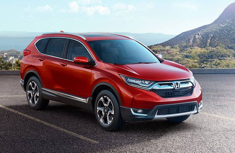 2018 Honda CR-V parked in a park lot near some water