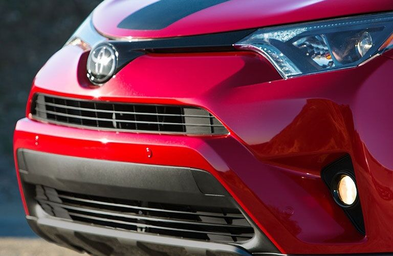 2018 Toyota RAV4 exterior shot closeup of grille, fascia, and headlights
