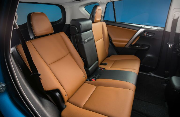 Interior view of the tan and black back seats of a 2018 Toyota RAV4