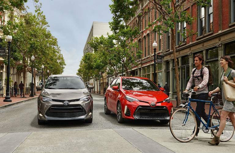 two 2018 Toyota Corolla models stopped on the street