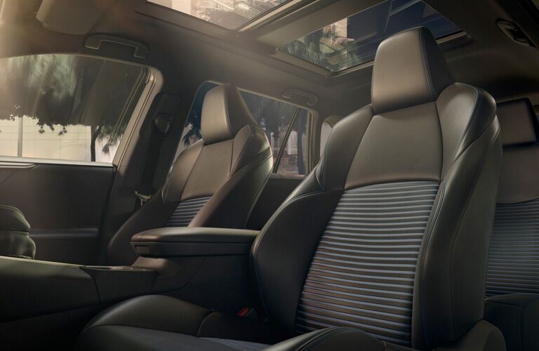 2019 Toyota RAV4 interior shot of softex faux leather seating surfaces with sun coming in from the panoramic moonroof