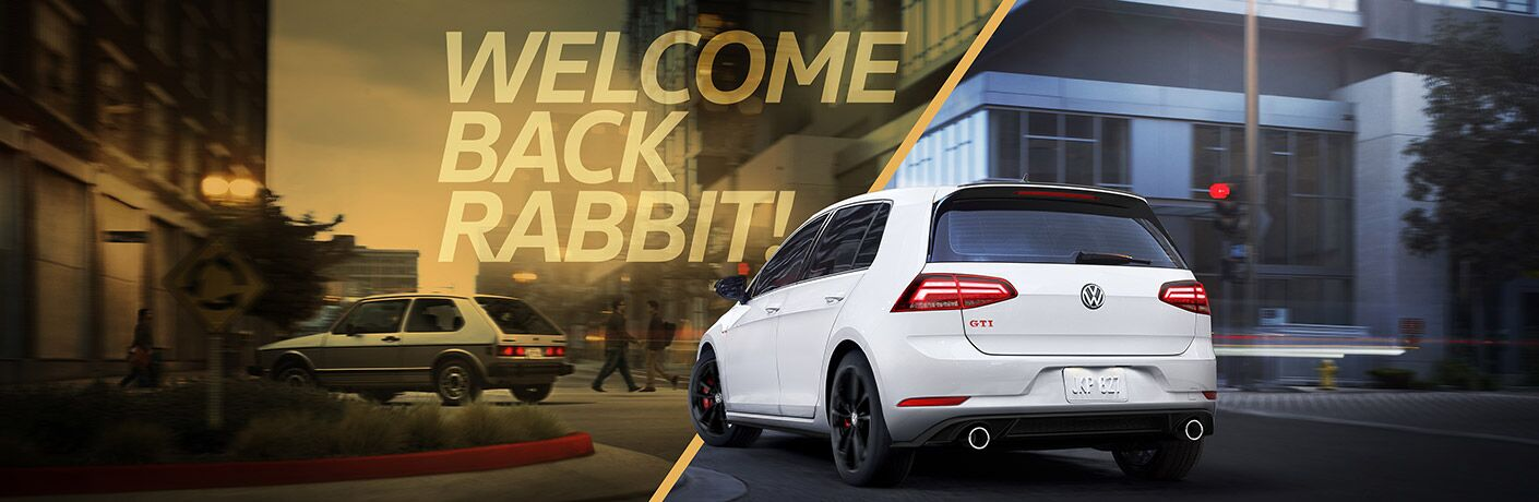 "A 2019 Volkswagen Golf GTI Rabbit Edition drives down a city street with the text ""Welcome Back Rabbit!"" above it"