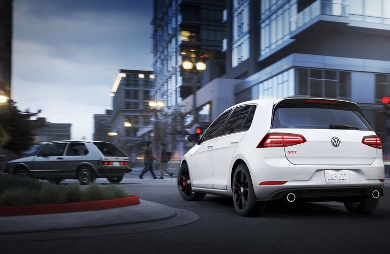 2019 Volkswagen Golf GTI Rabbit Edition driving down a city street