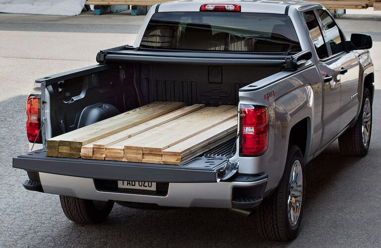 View of the truck bed of the 2018 Chevy Silverado filled with lumber
