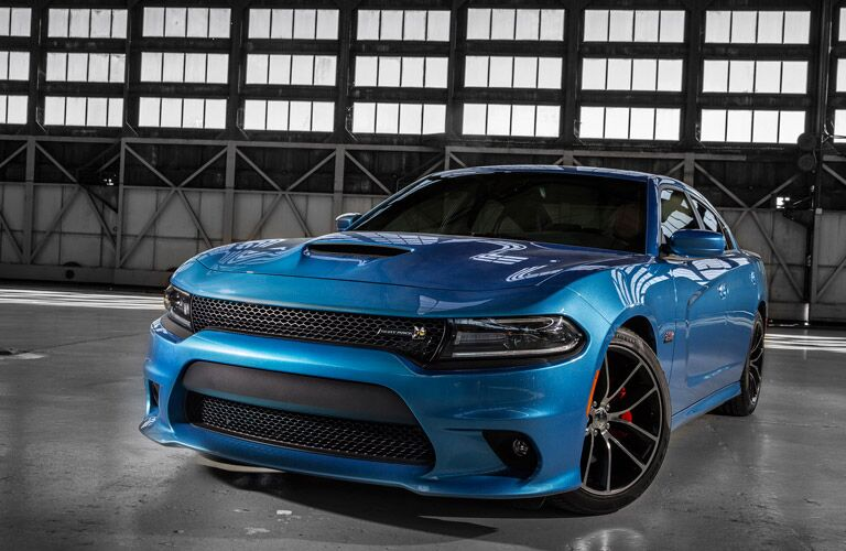 Blue 2016 Dodge Charger parked in a garage.