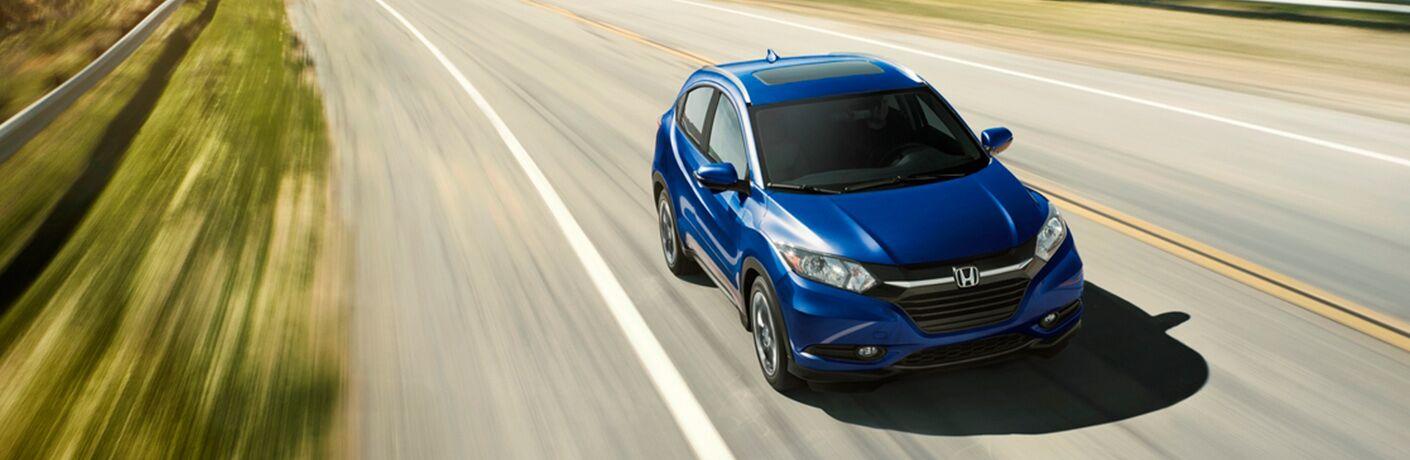 Blue 2018 Honda HR-V zooms up a highway.