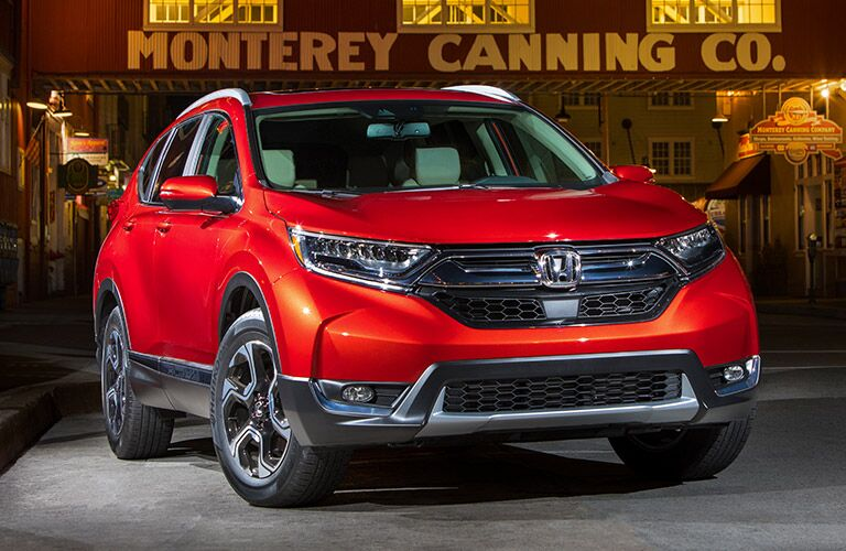 Exterior view of the front of a 2019 Honda CR-V in front of an old-style canning company.
