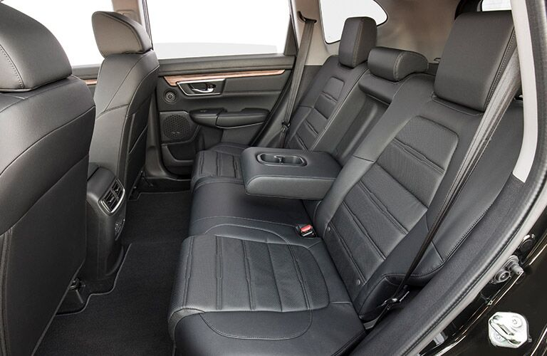Interior rear seats of a dark gray color in a 2019 Honda CR-V.