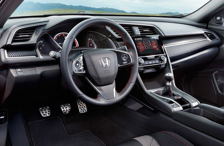 Interior front cabin of a 2019 Honda Civic coupe.