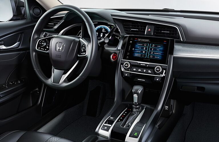 Interior cabin view of the driver's region of a 2019 Honda Civic.