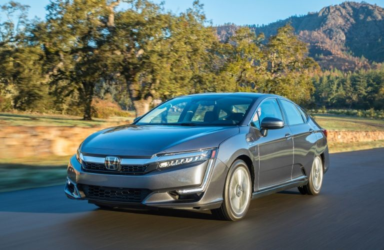 Gray 2020 Honda Clarity Plug-In Hybrid on a Country Highway