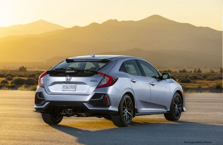 Silver 2020 Honda Civic Hatchback Rear Exterior in Desert with Black Prototype Model Shown Text in Lower Right Corner