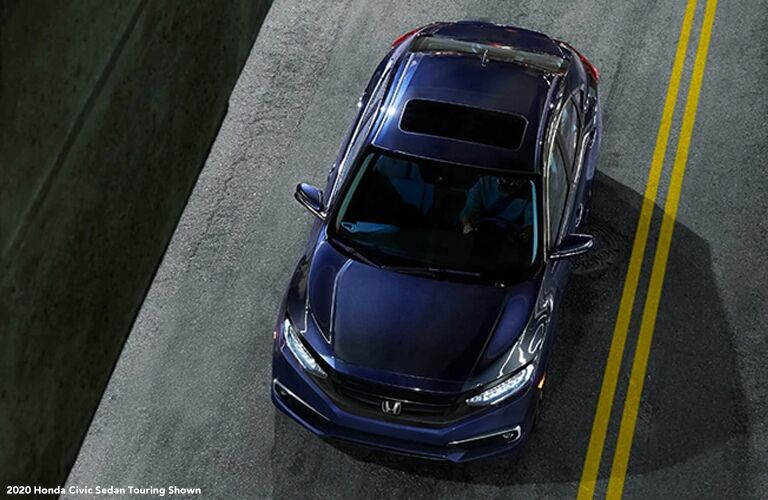 Overhead View of Blue 2020 Honda Civic Sedan Touring on a Highway with White 2020 Honda Civic Sedan Touring Shown Text in Lower Left