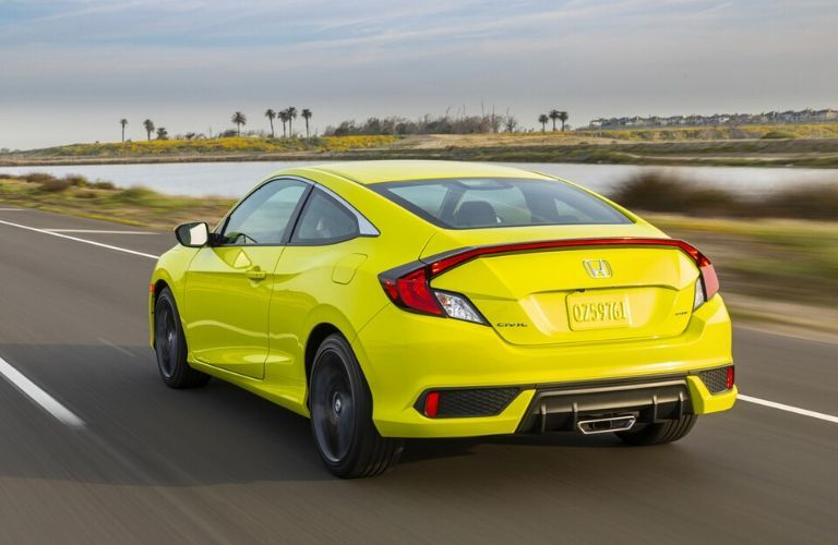 Yellow 2020 Honda Civic Coupe Rear Exterior at the Beach
