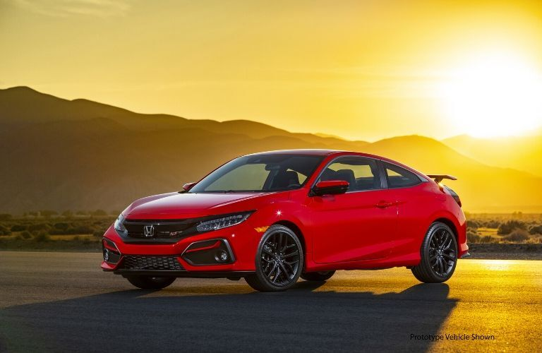 Red 2020 Honda Civic Si Coupe at Sunset with Black Prototype Vehicle Shown Text in Lower Right Corner