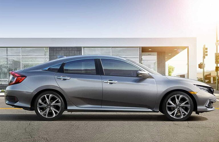 Silver 2021 Honda Civic Sedan Side Exterior on a City Street