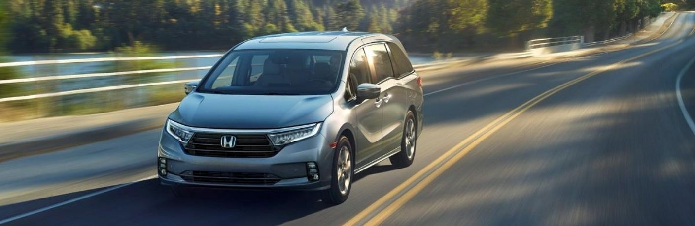 Silver 2021 Honda Odyssey on a Coast Road