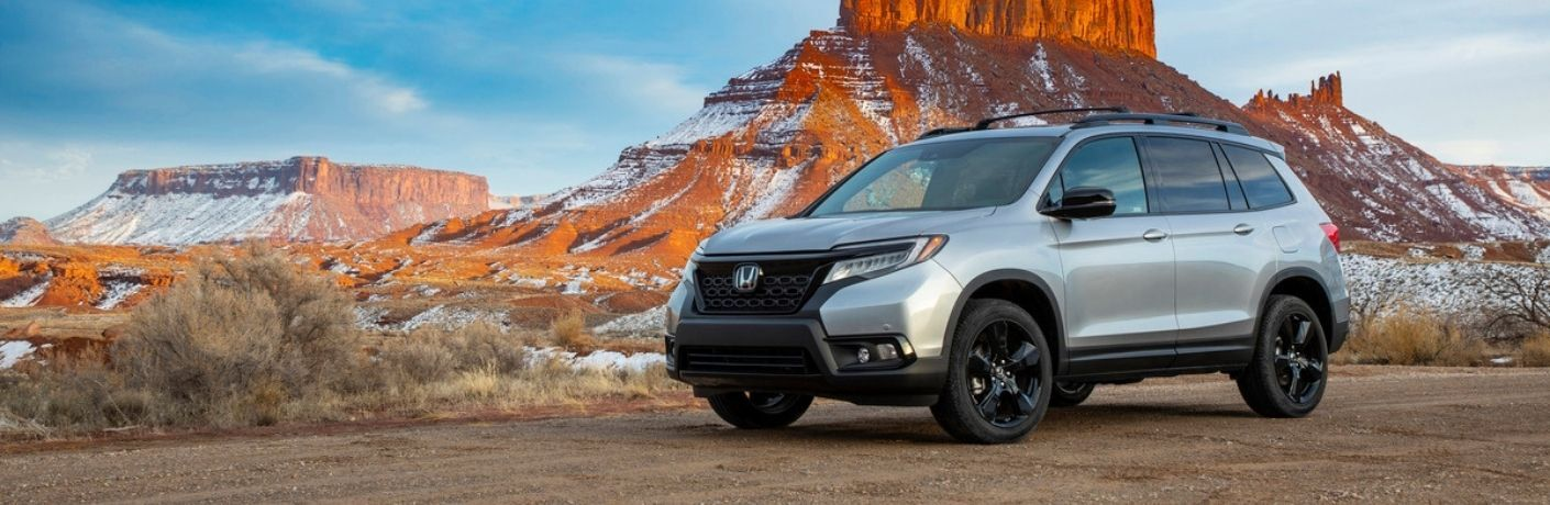 Silver 2021 Honda Passport in Desert in Winter
