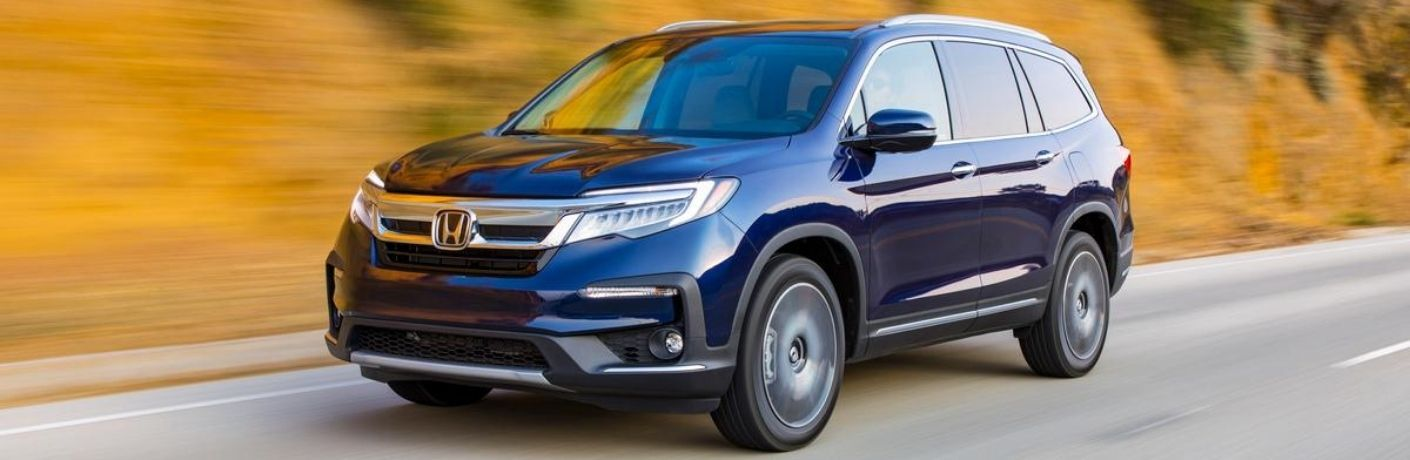 Blue 2021 Honda Pilot on a Country Road