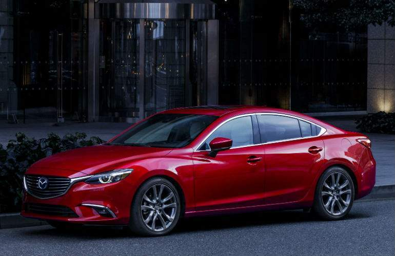 2017 Mazda6 parked by a curb at night