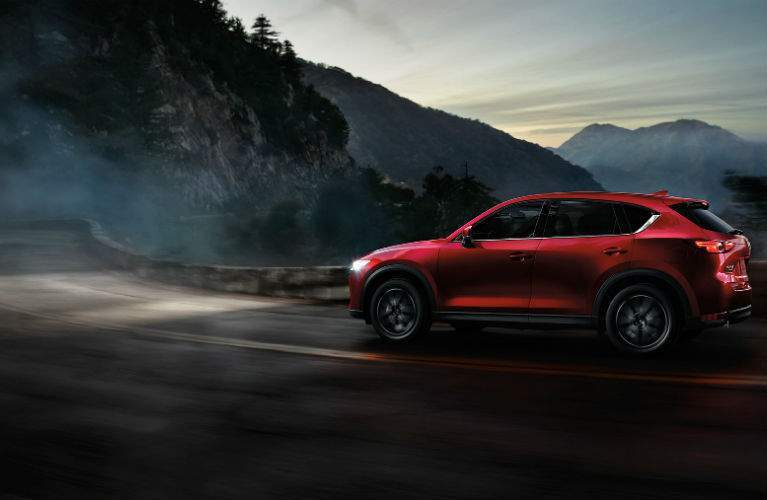 2017 Mazda CX-5 driving in dark mountains