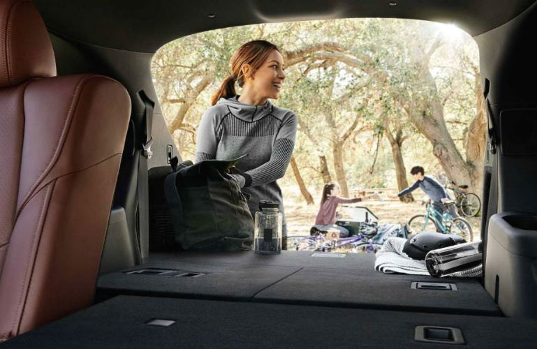 2018 Mazda CX-9 with image of a family camping from cargo area
