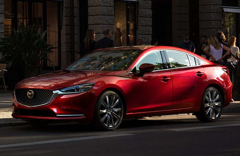 2018 Mazda6 parked by a curb and a group of people