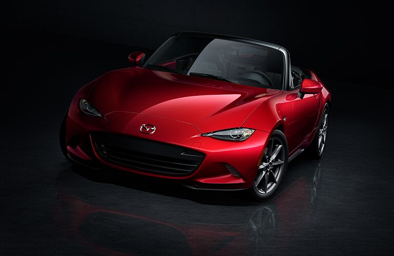 2018 Mazda MX-5 Miata with retractable roof in a dark room