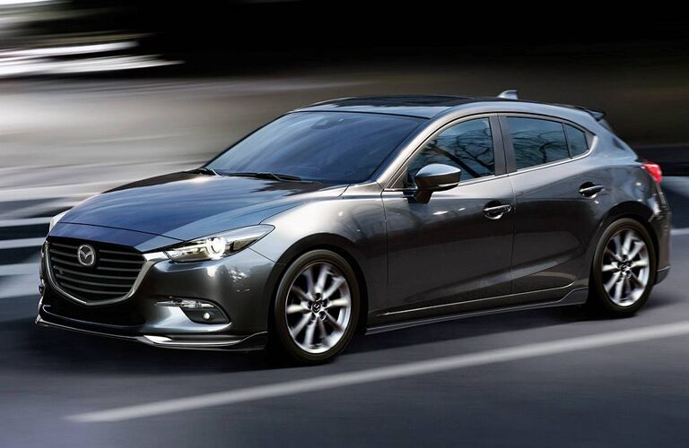 2018 Mazda3 5-Door driving fast with background blurring