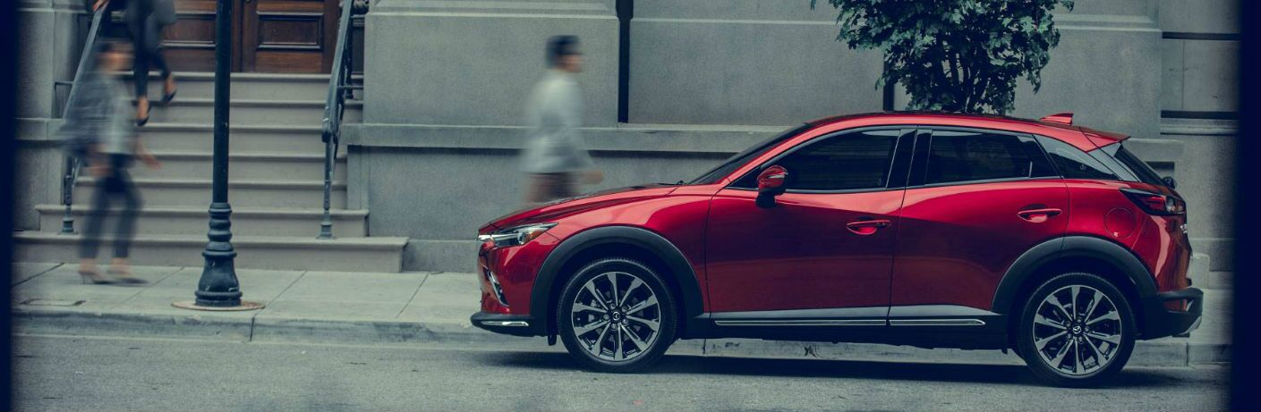 2019 Mazda CX-3 parked by a building with people walking by